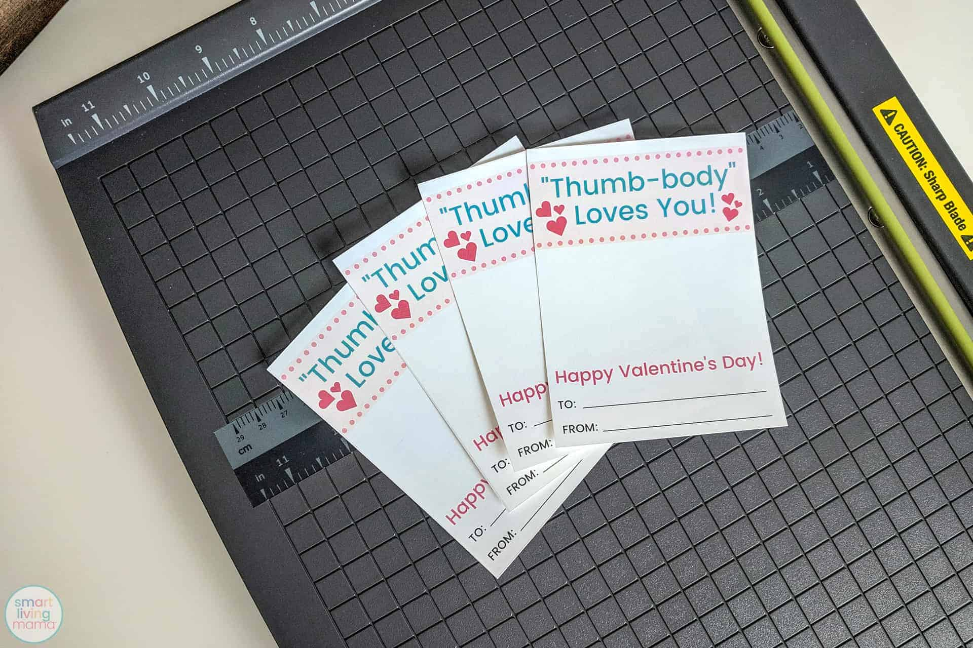Smart Living Mama - Four cut out cards placed on top of paper cutter