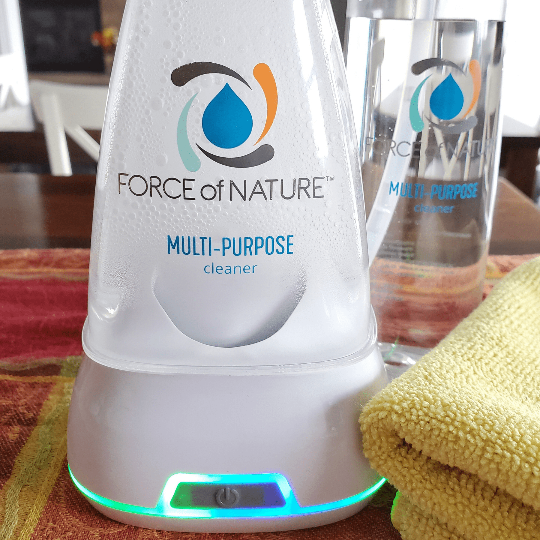 Force of Nature non-toxic cleaner bottle and electrolyzer base sitting on a kitchen countertop