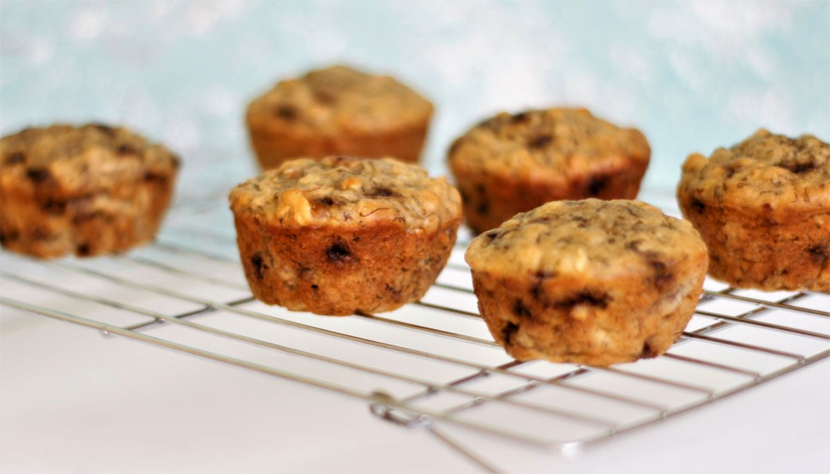 a cooling rack with banana muffins