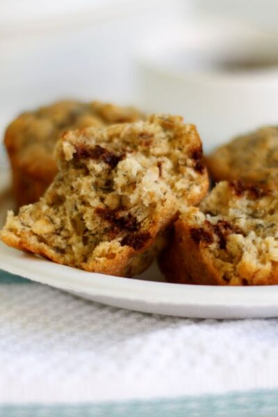 a plate of banana muffins with a cup of coffee