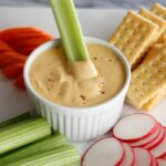 beer cheese plater with carrots, celery and crackers