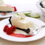 A slice of key lime pie with chocolate crust
