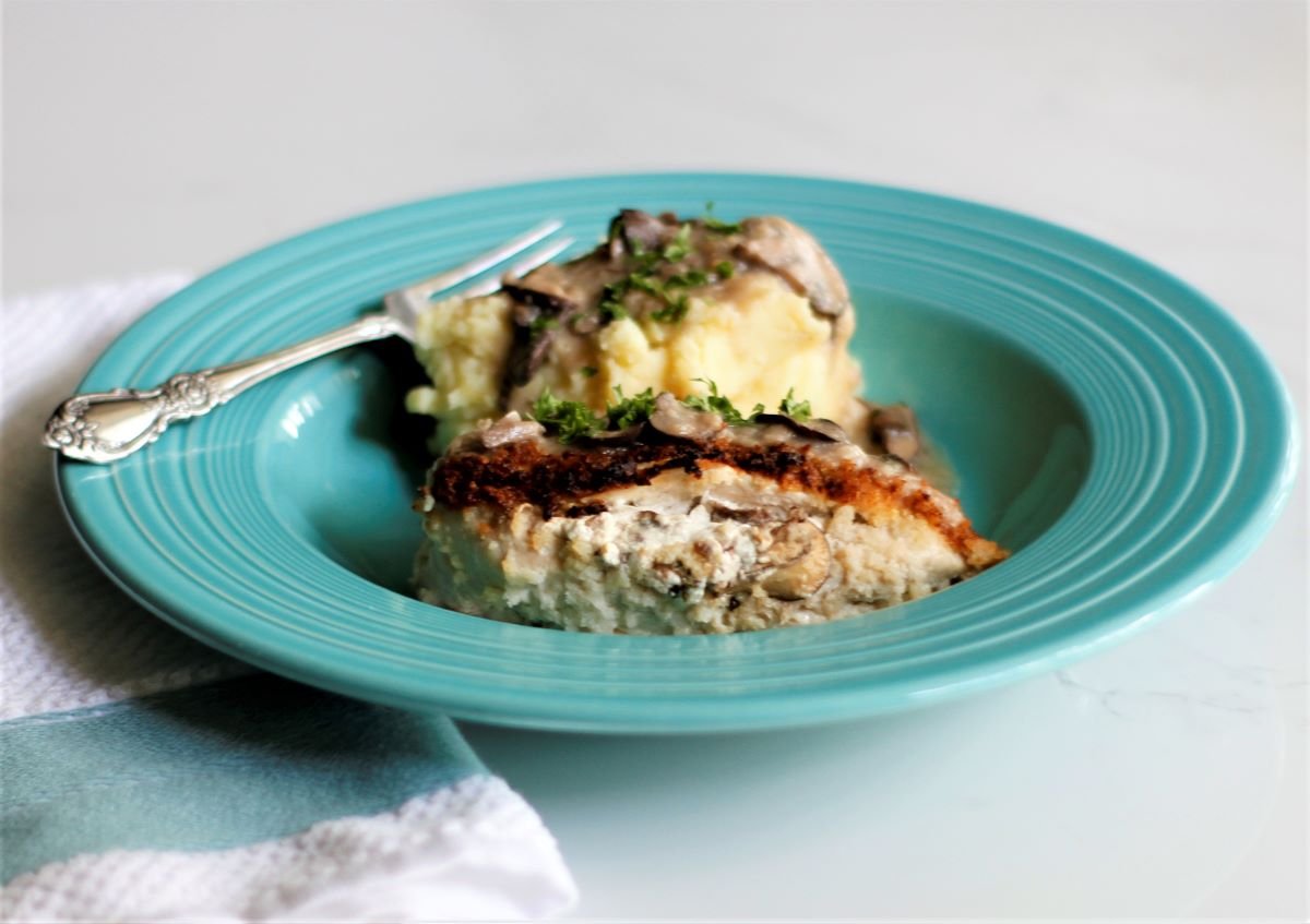 Stuffed chicken breast with mashed potatoes and mushroom gravy