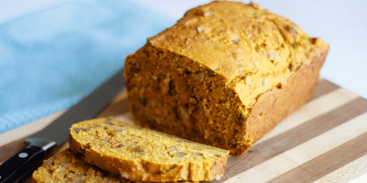 A loaf of pumpkin bread with raisins and walnuts