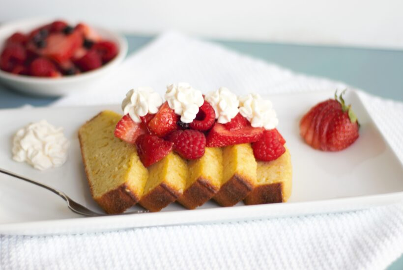 Olive oil cake with mixed berries and cream