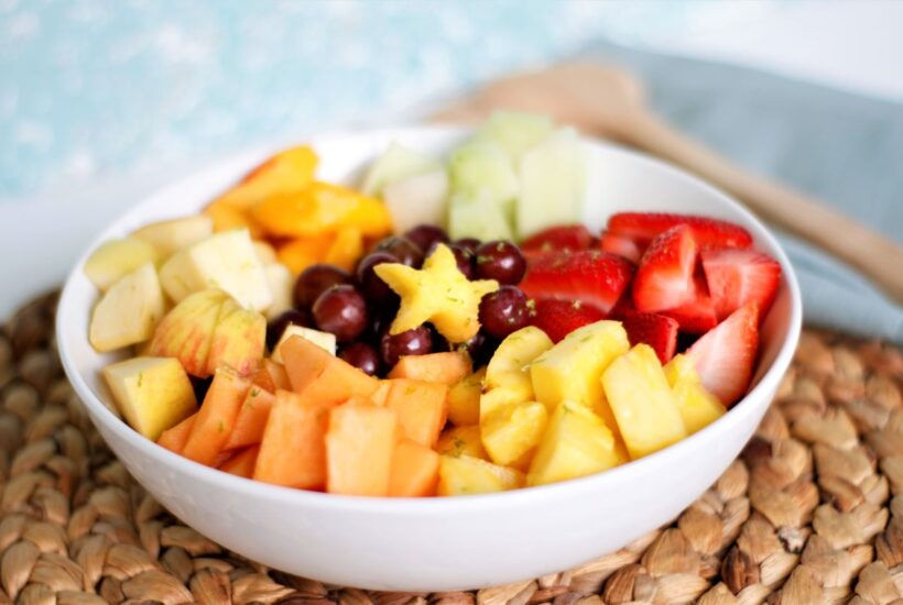 a bowl with honey lime fruit salad
