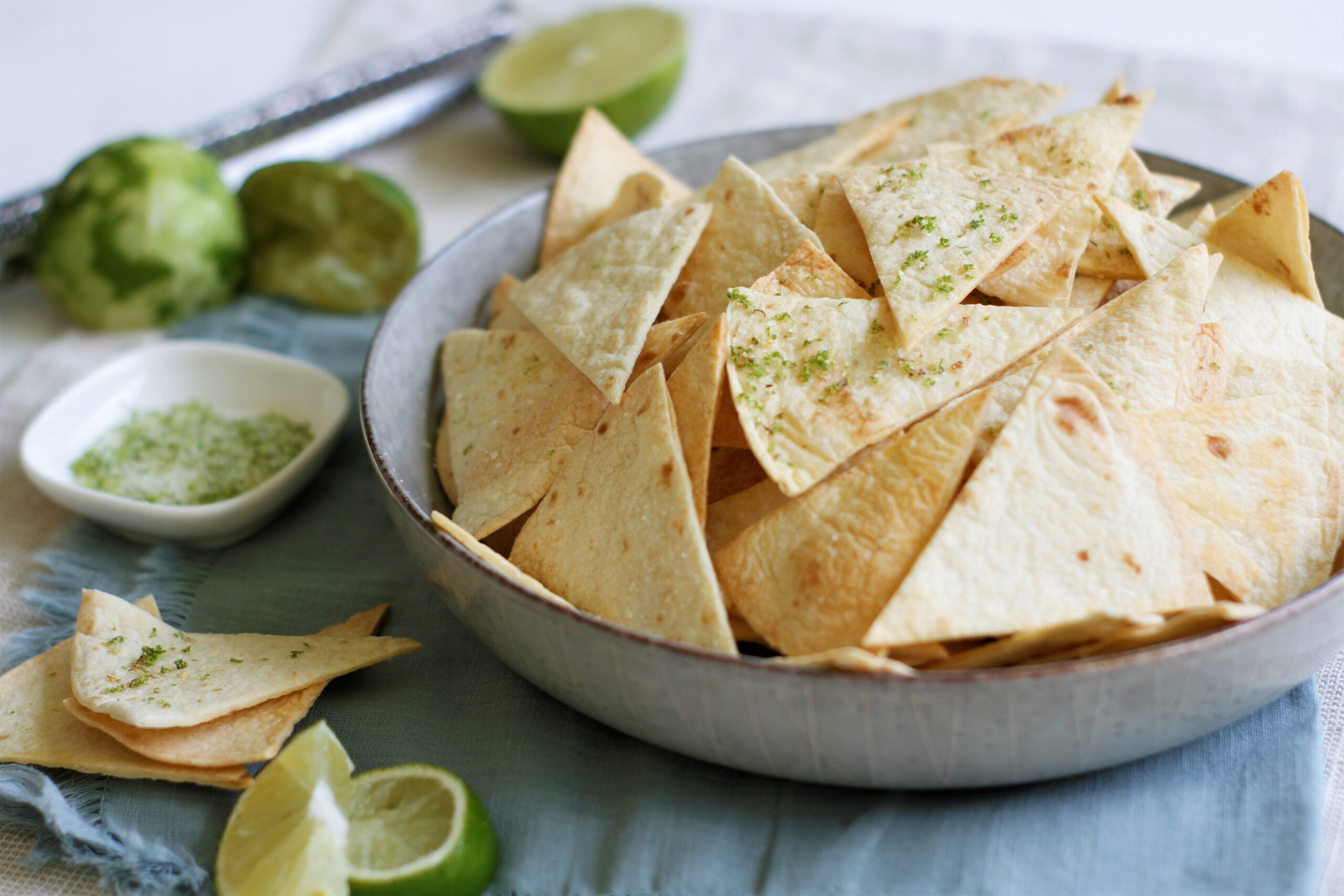 a bowl of homemade lime tortilla chips