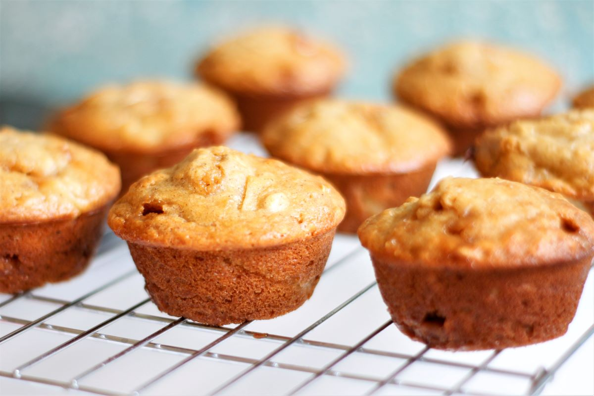 A cooling rack with caramel apple muffins cooling.