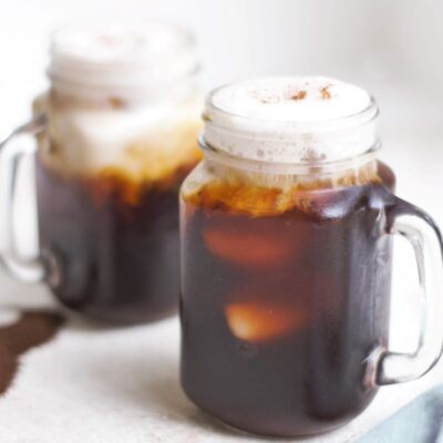 two mugs of cold brew with cinnamon almond milk