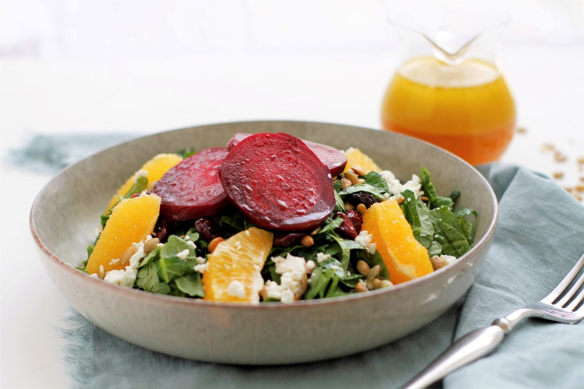 A serving dish with roasted beet salad and citrus vinaigrette