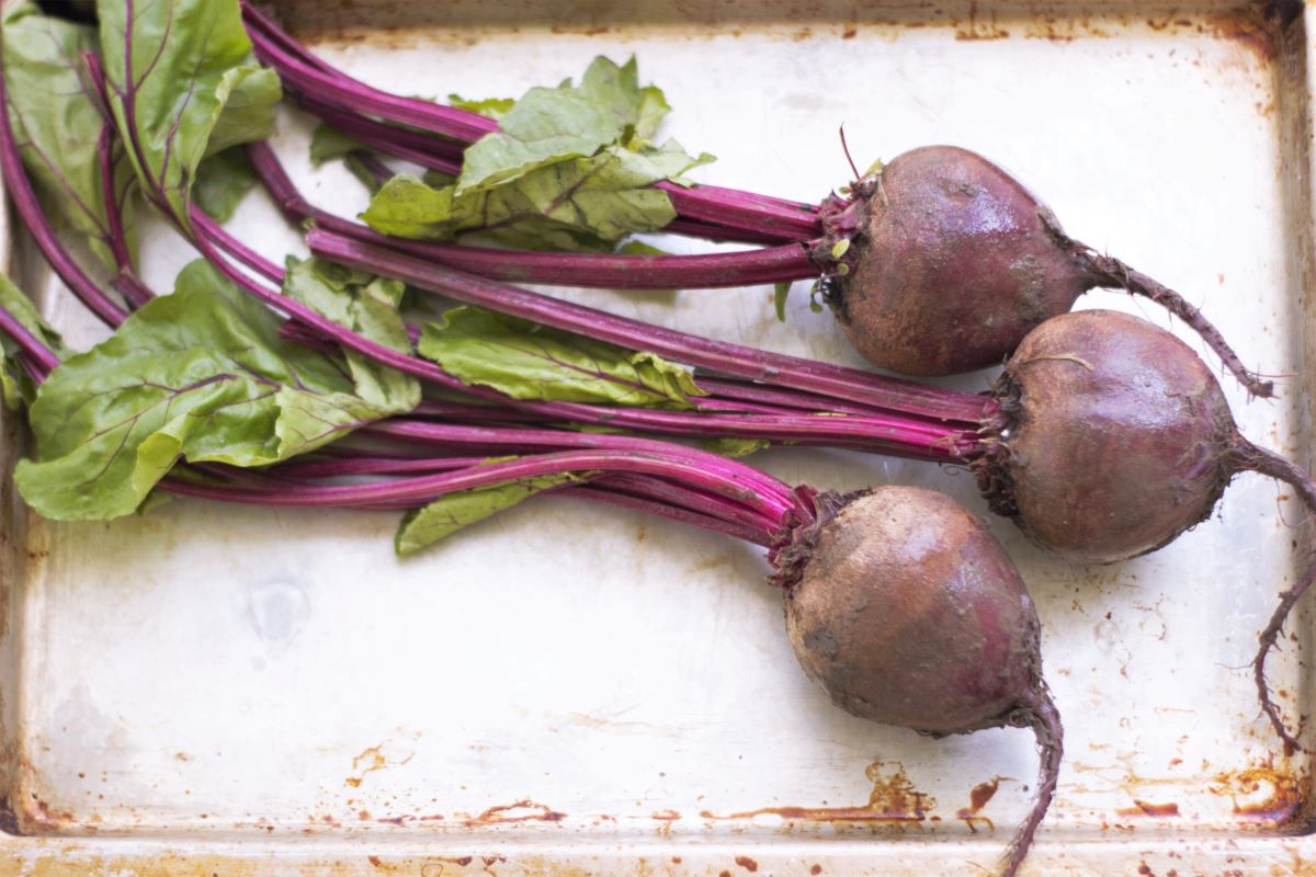 a baking sheet with a bunch of beets