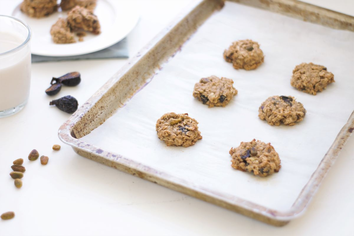 Oatmeal breakfast cookies out of the oven on a cookie sheet