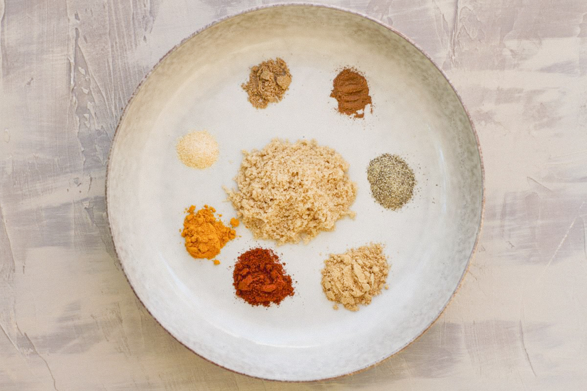A bowl with spices to make Moroccan spice rub