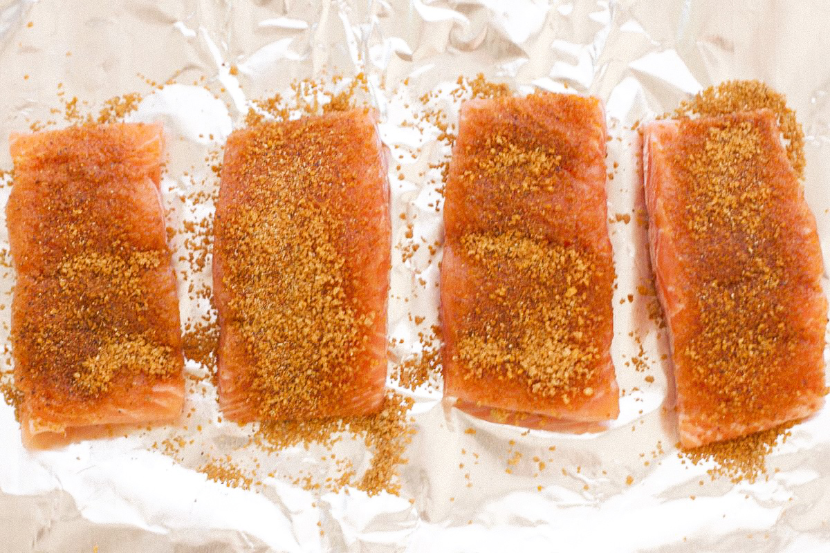 Salmon on foil lined baking sheet with Moroccan spice rub
