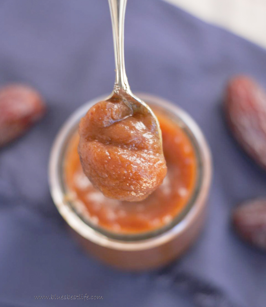 A spoonful of date paste in a jar