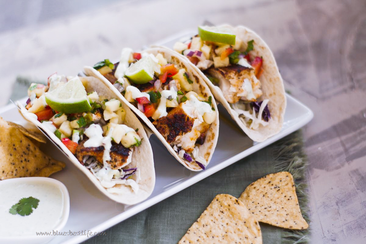 3 blackened fish tacos in a stand