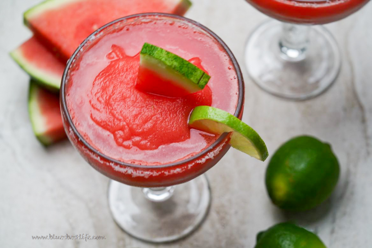 A watermelon Margarita in a glass with salted rim