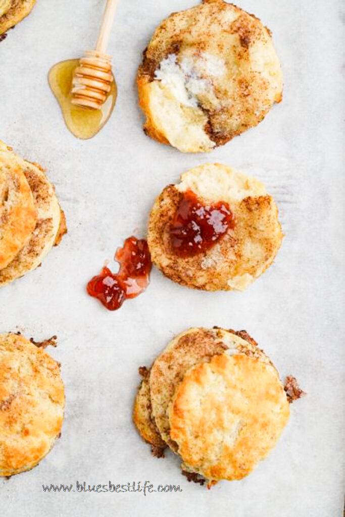 cinnamon biscuits with honey and jam on a baking tray