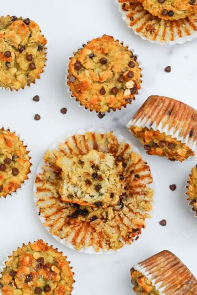 almond flour banana muffins on a counter top with a few chocolate chips