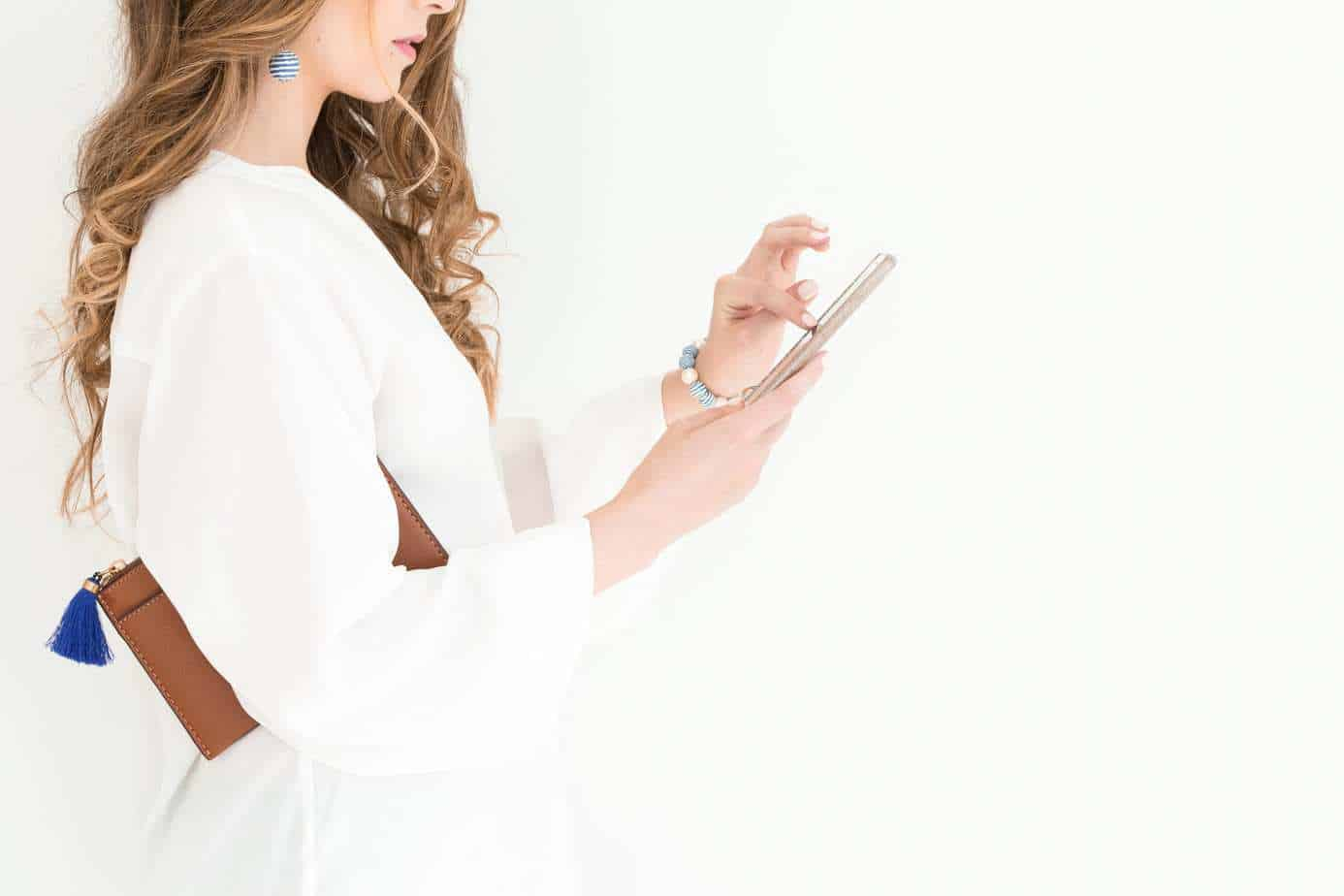 woman on mobile phone standing connecting with the outer world is why other people's opinion influences us